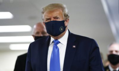 President Donald Trump wears a mask as he walks down the hallway during his visit to Walter Reed National Military Medical Center in Bethesda-Coronavirus Vaccines Delivery-ss-featured