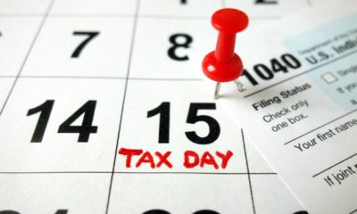 Calendar showing date April 15 2020 with 1040 form, tax day in USA-tax day-ss-featured