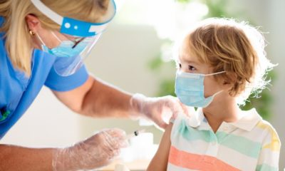 Coronavirus vaccination. Covid-19 vaccine. Doctor vaccinating child-COVID-19 Vaccine For Kids-ss-featured