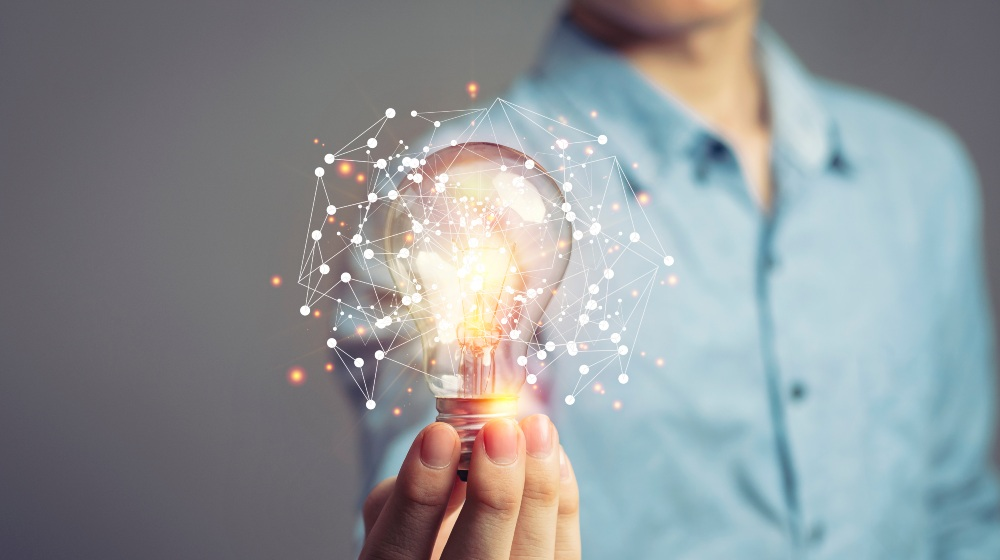 Man holding light bulbs, ideas of new ideas with innovative technology and creativity-Infinite Innovation-SS-Featured