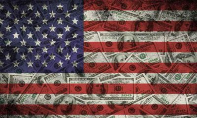 Many US 100 dollars, USA flag-Dalio Advises-ss-featured