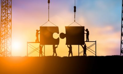 Silhouette Team business engineer work connecting jigsaw puzzle pieces together Teamwork potential and motivate employee to growth-Capital Goods-ss-featured