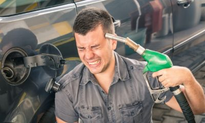 Young adult shooting himself over crazy petrol and fuel prices-$3 per gallon gas prices-ss-featured
