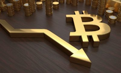 Golden bitcoin symbol and arrow down | After Hitting $63K, Bitcoin Prices Fell 19% Over The Weekend | Featured
