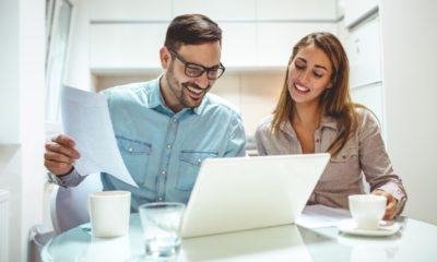 Shot of a young couple using a laptop while working on their home finances | Avoid These Five Mistakes When Submitting Your Business Plan | Featured