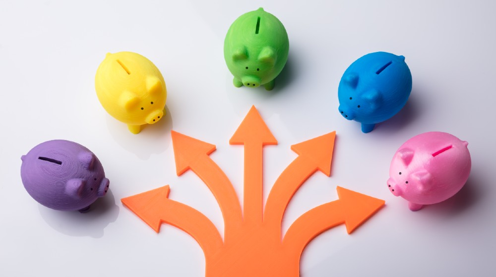 Various Arrow Symbols Showing Direction Towards Colorful Piggybanks-funding options-ss-featured