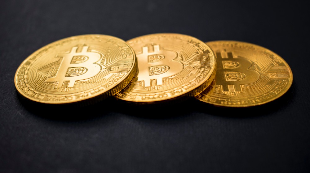 three gold-colored bitcoins   Bitcoin Prices Fall Below $50,000 As Tax Fears Surface   Featured