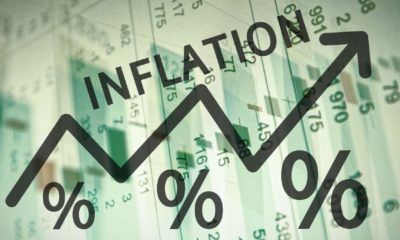 Word Inflation on up trend arrow, with financial data visible on the background | Inflation Explained | Featured