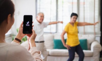 Asian woman using mobile phone take video clip of senior people dancing to share on tiktok application | Why And How To Leverage TikTok For Influencer Marketing | Featured