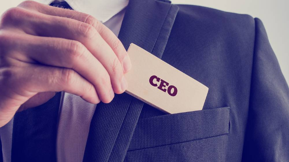 Retro style image of a businessman showing a wooden card reading - CEO   Are You the CEO of Your Life   featured