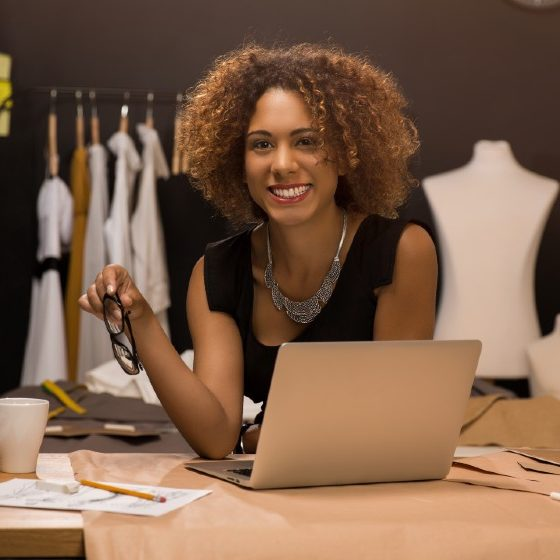 Two young entrepreneur women, and fashion designer working on her atelier | How to Project Confidence as an Entrepreneur | featured
