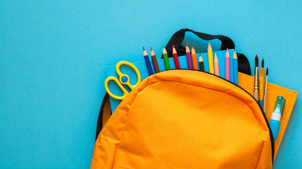 Back to school concept. Backpack with school supplies | America Braces For School Supplies Shortage | featured