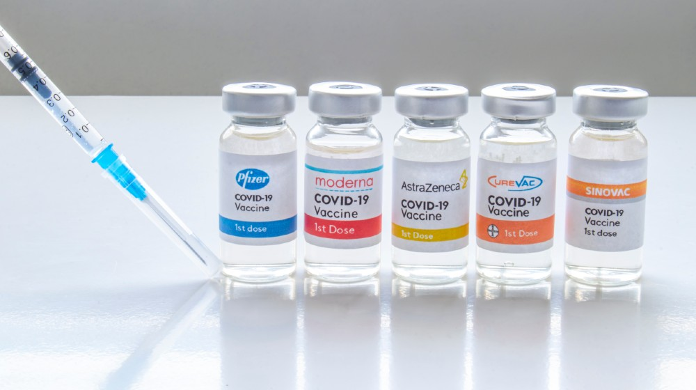 Several vials vaccine bottles of covid-19 immunization popular vaccines brands in the world | WHO Warns Against Mixing Different COVID-19 Vaccine Brands | featured