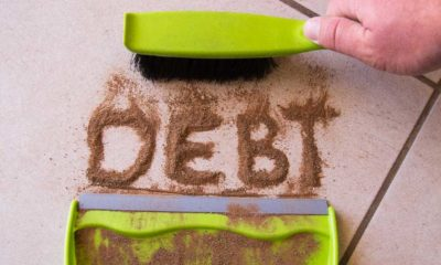 Sweep debt clean concept with debt written in dirt on a floor and a person is about to sweep the debt dirt | How To Get Out of Debt Without Losing Time and Money | featured