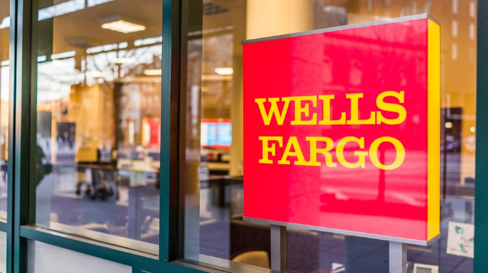 Wells Fargo bank entrance with sign | Wells Fargo Surprisingly Shuts Down Personal Credit Lines | featured