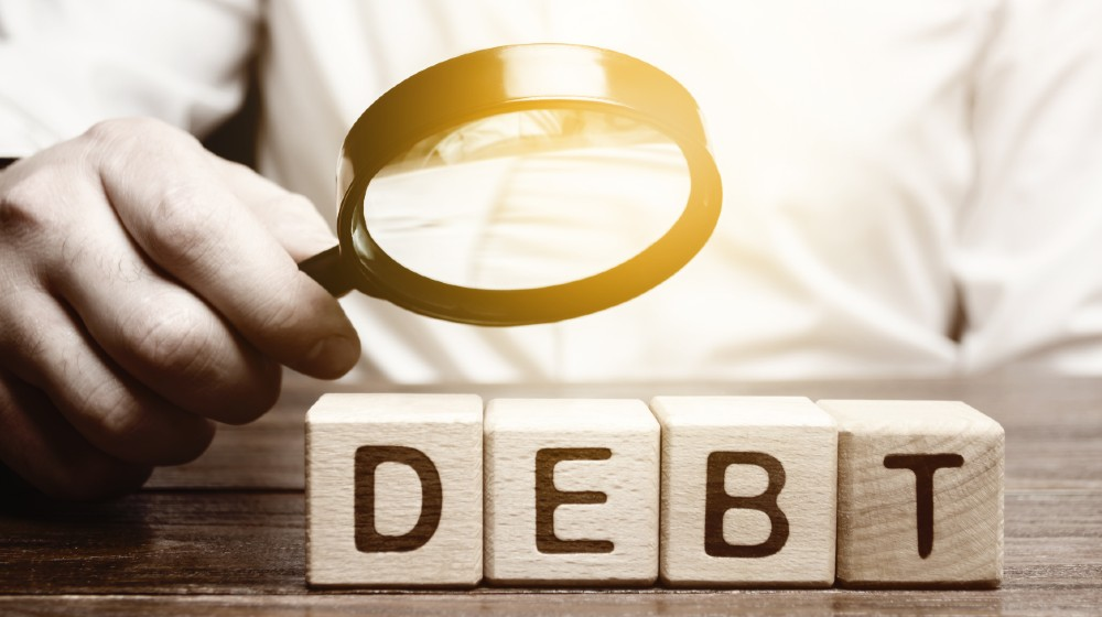 Businessman explores debt. Study of the structure of debt | All About Cleaning Up Your Credit & Choosing the Right Service | featured