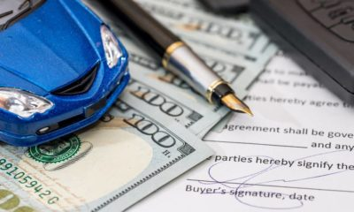 document, dollar, pen, calculator and toy car with keys for design   Can a Down Payment of $500 Get You An Auto Loan?   featured