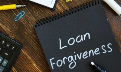 Loan forgiveness note on notepad black page | Troubled student loan forgiveness program gets an overhaul | featured
